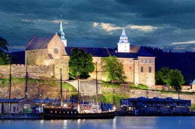 View of waterside fortress of Akershus at night