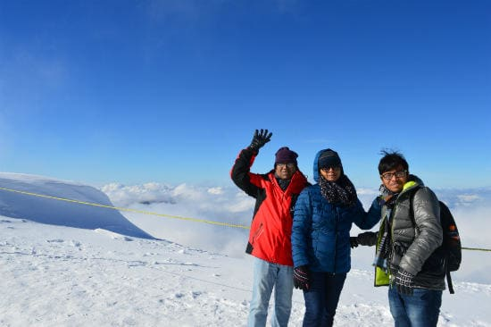 Eurail customer testimonials | Three family looking front on top of the snow mountain in the morning