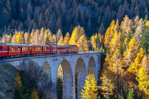 Fall destinations in Europe | Bernina Express scenic train in Switzerland in fall