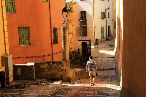Everything about Eurail | Male walking through the backstreets of a hidden gem of the French Riviera Menton, France