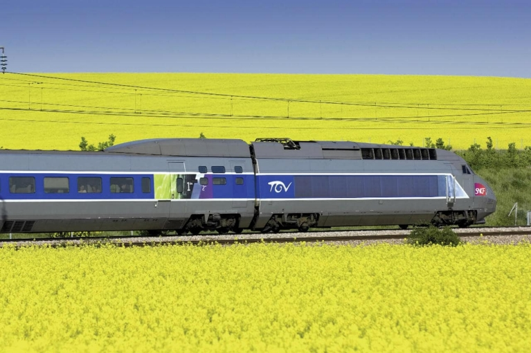 TGV high-speed train crossing fields in France