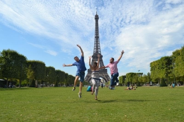 Travelers jumping in front of the Eiffel Tower in Paris