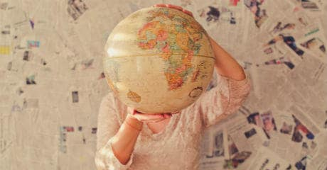 why_eurail_is_your_greenest_choice_female_holding_a_globe_in_front_of_her_face