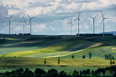 Why Eurail is your greenest choice | Windmills on the great green field in Mistelbach, Austria