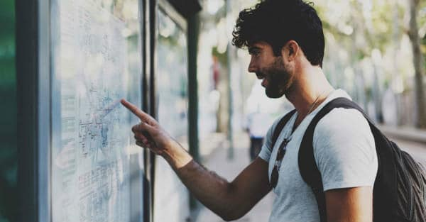 Everything about Eurail | Young bearded traveller man searching for the route in the map