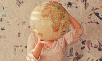 girl-holding-globe-in-hands