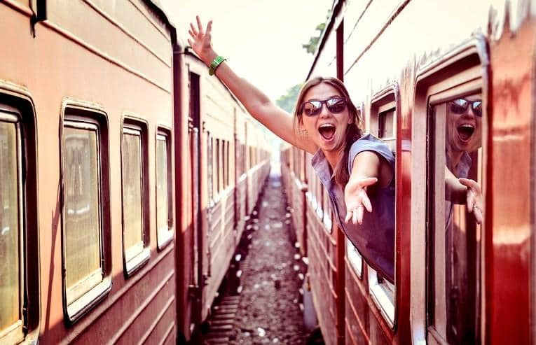 cheerful_woman_looking_out_the_window_of_the_old_train_edited
